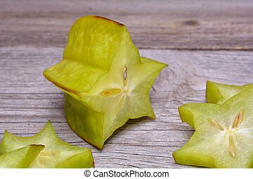 Carambola (Star Fruit) on wooden background