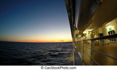 Cruise ship sails into the sunset