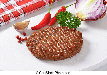 Grilled Beef Burger Patty on cutting board