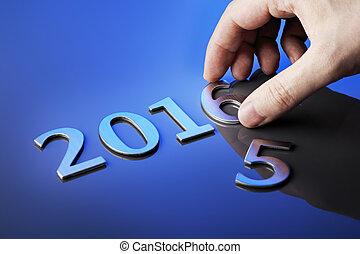 Welcome 2016 - Man making number 2016 using metallic...