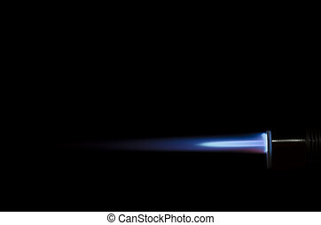 Torch flame  - Blue torch flame against black background