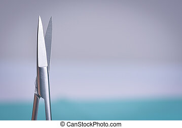 Surgical scissors against light background