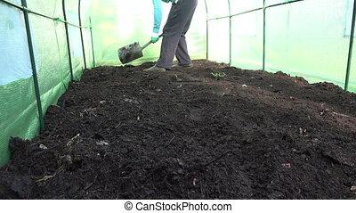 man dig soil greenhouse - gardener man prepare dig ground...
