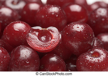 Sour cherry fruits close-up with dewdrops