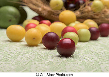 Cherry plums group selective focus - Cherry plums group on a...