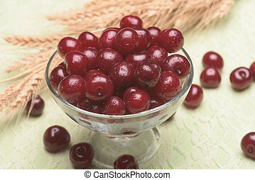 Sour cherry in a glass bowl against a light background