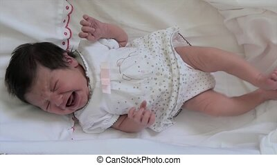 newborn baby girl crying - capturing moments in a little...