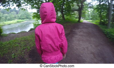 Little girl going to the river.