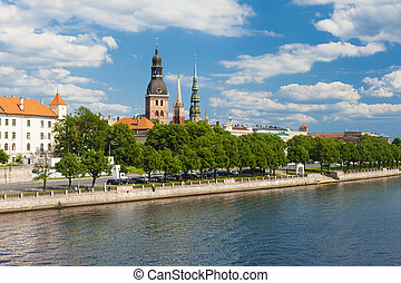 Riga - Towers of Riga and castle seen across river Daugava...