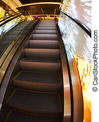 Escalator in the big shopping center in the movement