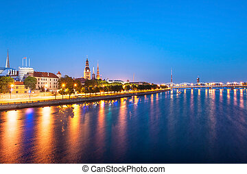 Riga - Skyline of Riga seen across the river Daugava after...