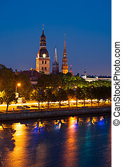 Riga - Towers of Riga seen across the river Daugava after...