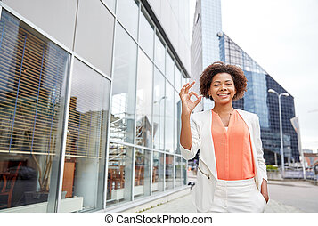 happy young african american businesswoman in city -...