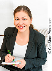 Young successful woman with a notebook in hands