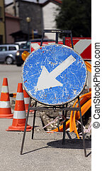 road sign near excavation for the laying of telecommunications infrastructure