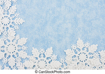 Snowflake Border - Snowflakes making a border on a blue...