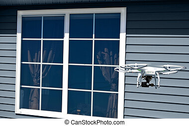 white drone with camera by window - White drone with camera...
