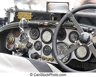 Dashboard and steering wheel in interior of british classic sport car isolated on white background