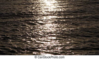 Sunrise reflection - Reflection of the sun on the water with...