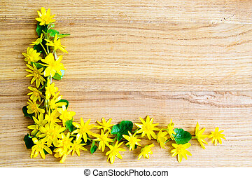 Background with yellow flowers over wooden table