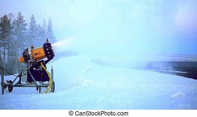 snow making system in mountain on the ski hill in winter -...