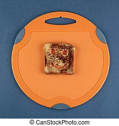 Happy toast on a cutting board