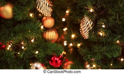 Decorated Christmas tree on blurred, sparkling and fairy...