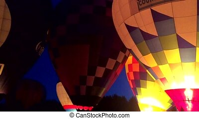 Hot Air Balloons at Night - Inflating a hot air balloons for...