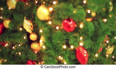 Christmas decoration- hanging lanterns with holly twigs on...