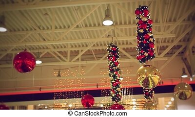 Decorated red balls white small lightbulbs for christmas on...