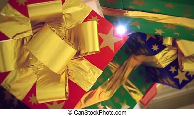 gift boxes with bows hung from the ceiling. Decorated in shopping center