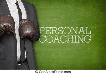 Personal coaching on blackboard with businessman on side