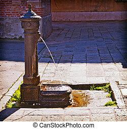 Venice, Italy - ancient iron fountain