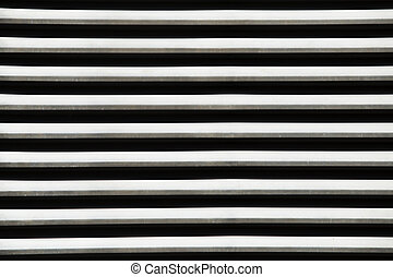 black and white stripes - pieces of metal and shadow form a...