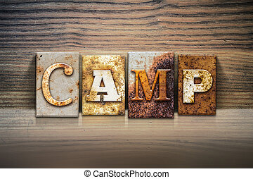 Camp Concept Letterpress Theme - The word CAMP written in...