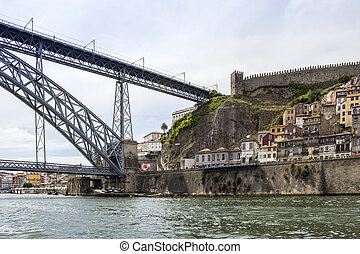 View of old downtown and famous Dom Luiz Bridge, Porto...