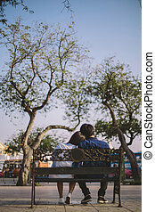 couple in park - Couple sitting in the park.