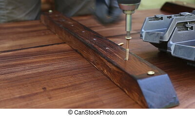 Man carpenter making table - Man carpenter making table and...