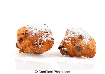 Dutch oliebollen with powder sucre as traditional food at...