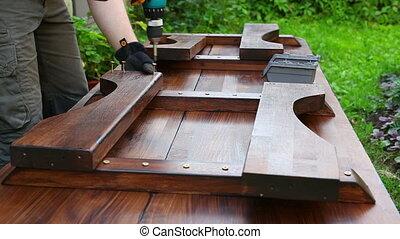 Man carpenter making table - Man carpenter making table fast...