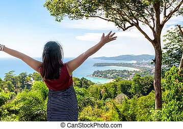 Woman tourist happy gestures on high scenic view for looking...