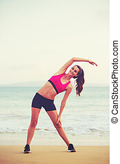 Fitness Woman Stretching - Young attractive fitness woman...