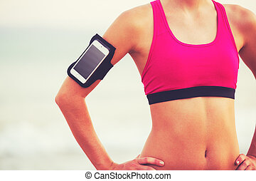Young Healthy Fitness Woman with Smart Phone - Active...