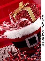 Christmas basket with candy canes and gift bags in...