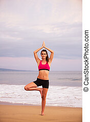 Yoga Woman on the Beach At Sunset