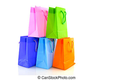 shopping bags - A pile of colorful paper shopping bags
