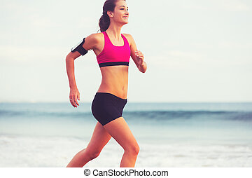 Sports Fitness Woman Running on the Beach at Sunset