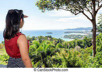Woman tourist on high scenic view for looking beautiful...