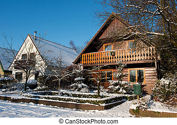 Snow on the wooden house - Snow on the wooden cabin house in...