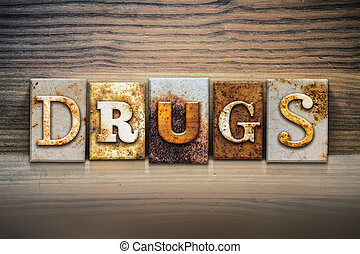 Drugs Concept Letterpress Theme - The word DRUGS written in...
